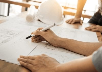 Man looking at plans for a new house